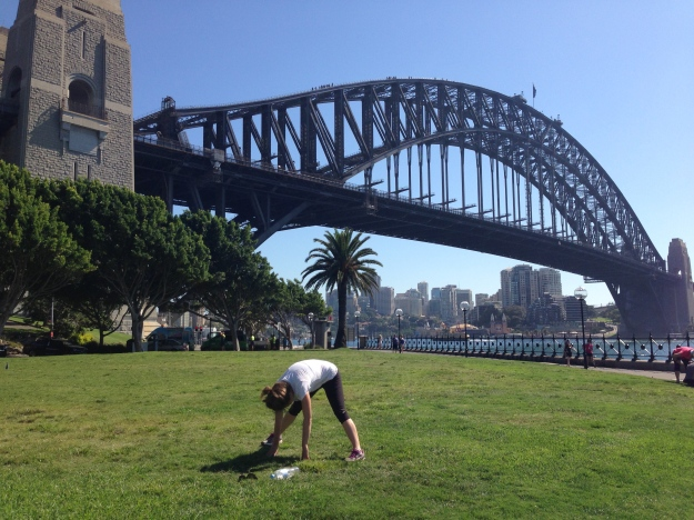 Jill breaking out a few shavasanas under the Sydney Harbor Bridge